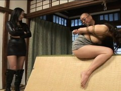 Tied up Asian babe gets...